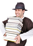 Young male holding books. With expression on his face Stock Image