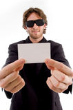 Young male holding business card Royalty Free Stock Photography