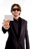 Young male holding business card Royalty Free Stock Photos