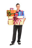 Young male holding gifts Stock Photography
