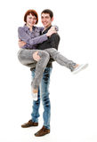Young male is holding girl. Young male is holding girl, isolated on a white background Royalty Free Stock Image
