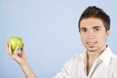 Young male holding an green apple Royalty Free Stock Photography