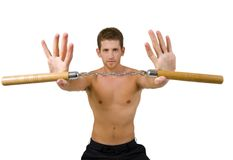 Young male holding nunchaku with open palms Royalty Free Stock Images