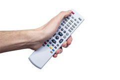 Young Male Holind Remote Controller. And pressing some button Stock Photos
