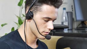 Young male home worker with headset Stock Photo