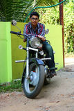 Young Male Indian on a Big Black Bike. Young Male Indian on a Big Black enfield Bike Stock Images