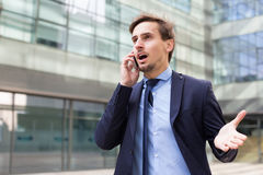 Young male in jacket talking on the phone Stock Photo