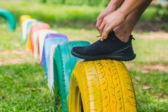 Young male jogger athlete bind showlace.  royalty free stock photo
