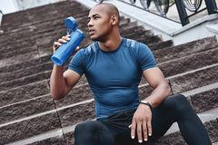 Young male jogger athlete training and doing workout outdoors in. City stock images
