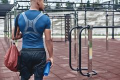 Young male jogger athlete training and doing workout outdoors in. City royalty free stock photo