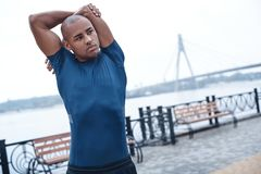 Young male jogger athlete training and doing workout outdoors in. City royalty free stock images