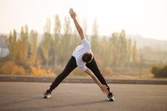 Young male jogger athlete training and doing workout outdoors royalty free stock photos