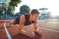 Young Man Working Out On Running Track royalty free stock photo