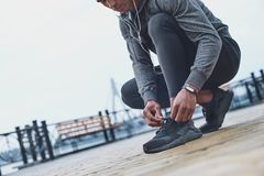 Young male jogger athlete training and doing workout outdoors in. City stock image