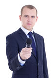 Young male journalist with microphone taking interview isolated. On white background Royalty Free Stock Photography