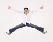 Young male jumping. Isolated against a white background stock images