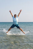 Young male jumping from the water Royalty Free Stock Images