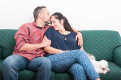 Young male kissing girlfrined forehead with love Royalty Free Stock Photo