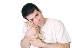 Young male with kitten Royalty Free Stock Photos