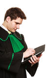 Young male lawyer hold tablet computer in open case. Technology and career legal advice. Young male lawyer hold tablet portable computer show advice and help Stock Photo