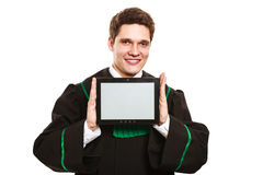 Young male lawyer hold tablet computer. Technology and career legal advice. Young male lawyer hold tablet portable computer show advice and help Royalty Free Stock Photos