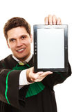 Young male lawyer hold tablet computer. Royalty Free Stock Photography