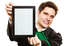 Young male lawyer hold tablet computer. Stock Images
