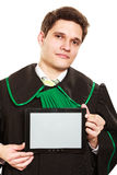 Young male lawyer hold tablet computer. Technology and career legal advice. Young male lawyer hold tablet portable computer show advice and help Royalty Free Stock Image