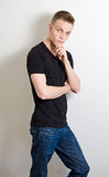 Young male leaning on wall portrait Royalty Free Stock Image