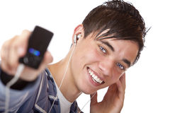 Young male listening mp3 music and shows player Stock Images