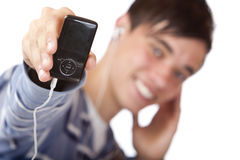 Young male listening mp3 music and shows player Stock Photos