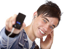 Young male listening mp3 music and shows player Royalty Free Stock Images