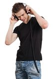 Young male listening to headphones Royalty Free Stock Images