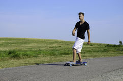 Young male on longboard Royalty Free Stock Image