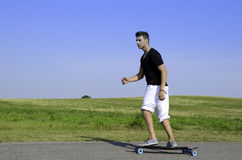 Young male on longboard Stock Photo