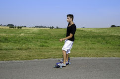 Young male on longboard Stock Photography