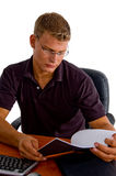 Young male looking in to book Stock Image