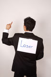 Young male with Loser sign. On his back. Comic image with copy space stock image
