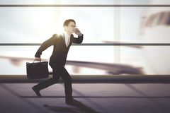 Male manager running on the airport terminal stock image