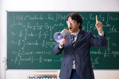 The young male math teacher in classroom royalty free stock photography