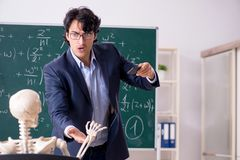 The young male math teacher and student skeleton stock images