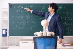 The young male math teacher and student skeleton. Young male math teacher and student skeleton royalty free stock photography