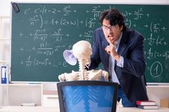 The young male math teacher and student skeleton. Young male math teacher and student skeleton stock photography