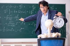 The young male math teacher and student skeleton. Young male math teacher and student skeleton stock images