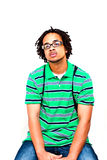 Young Male Model. Middle to upper twenty year old adult male model posing on a white background. Sitting on stool, wearing a backback, green striped polo shirt stock image