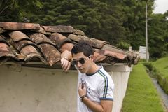 Young male model. In an old wall Stock Photography