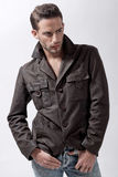 Young male model with brown jacket Stock Images