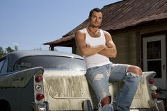 Young Male Model With Old Car royalty free stock photos
