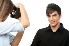 Young male model posing at camera. Royalty Free Stock Images
