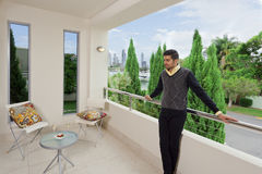 Young male on modern balcony Royalty Free Stock Photos